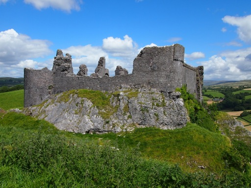 The strikingly impressive view of carreg cennen from upon an adjacent